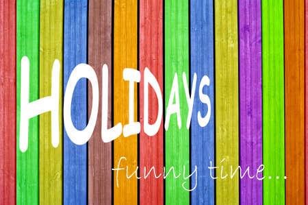 Inscription holidays on colourful background, colourful fence, colourful boards Reklamní fotografie - 15903580