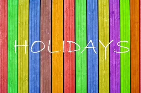 Inscription holidays on colourful background, colourful fence, colourful boards Reklamní fotografie - 15903646