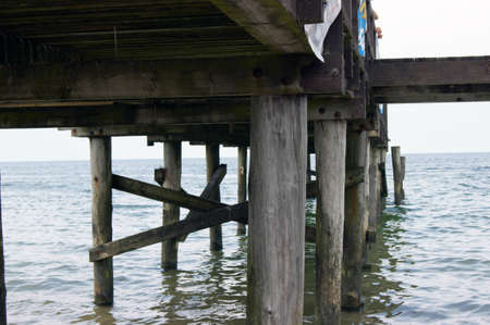 The wooden platform over water, photo from pit of platform Drewniany pomost nad woda Stock Photo