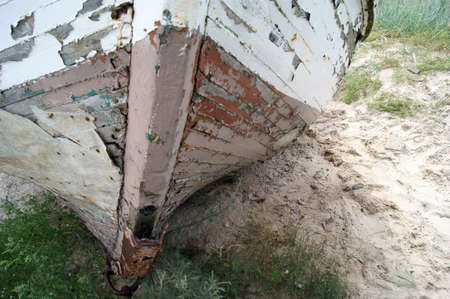 The old hulk of boat on bank of sea, on beach  Zdjęcie Seryjne