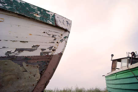 The old hulk of boat on bank of sea, on beach  Publikacyjne