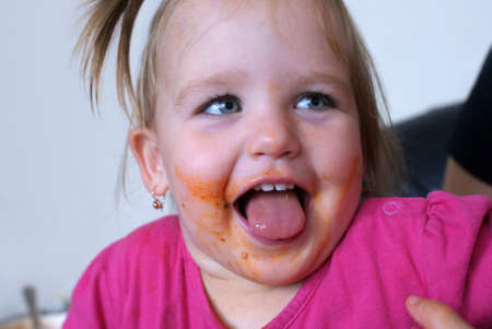 Little girl smeared with food