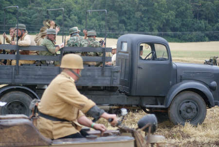 prisoner of war: German going with old military lorry soldiers  Editorial