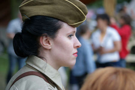 Woman soldier in cap, close relations