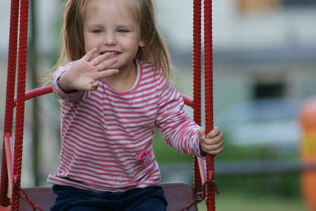 3 year old: 3 year old little happy girl on a swing
