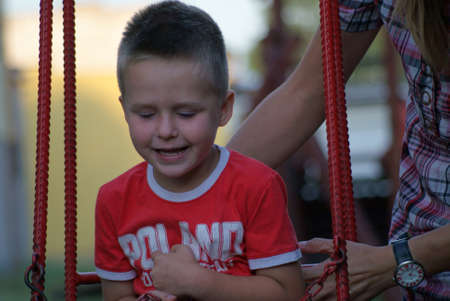 Young boy swinging on a swing
