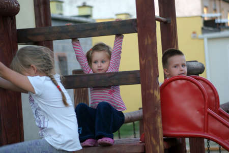 Three brothers and sisters on the playground Stock Photo