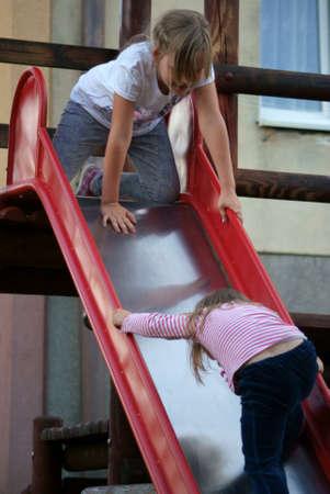 Sound girl on the slide Stock Photo