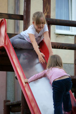 The girls help each other in the playground