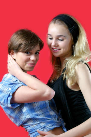 Two young women hugging each other  Friends  Stock Photo