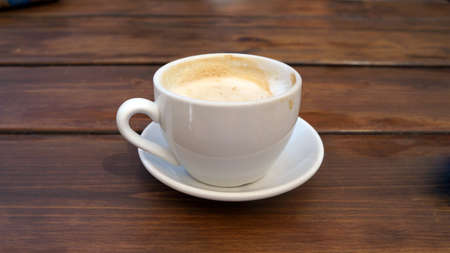 Cup of delicious coffee on a table in a restaurant  One by one, the view from up close                                 photo