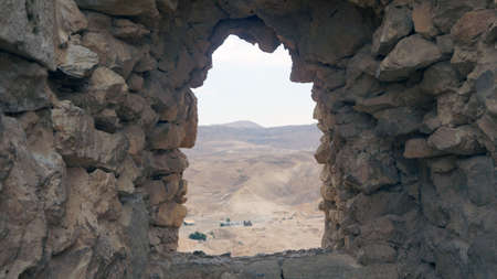 Ruins  Fortress Masada in Israel  Sand desert                                 Stock Photo
