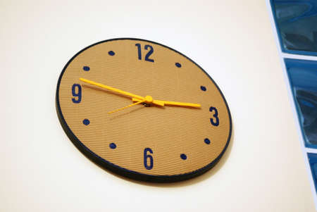 Large glowing colored clock on the wall