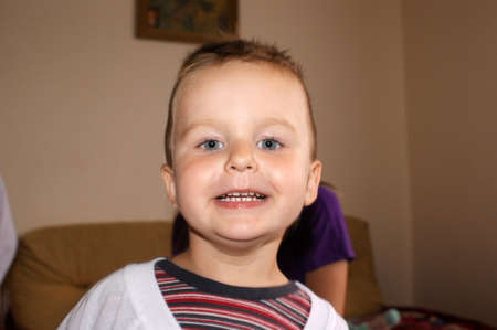 Small smiling boy in play
