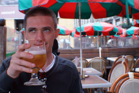 man drinking beer: White man drinking beer. Stock Photo