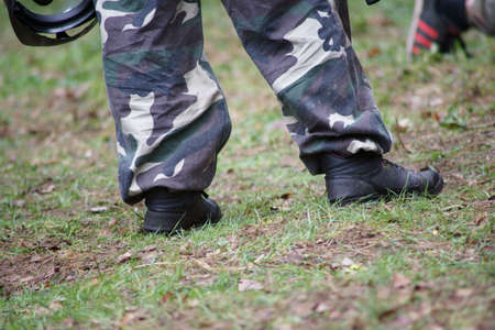 Paintball, legs player in uniform. Stock Photo