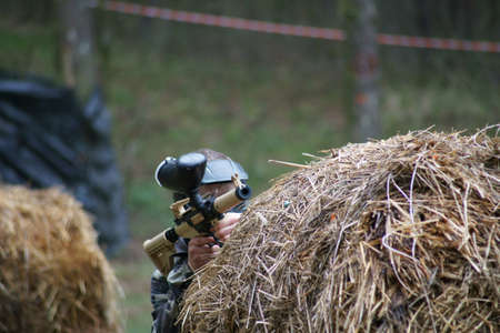 Paintball, small player with a gun.