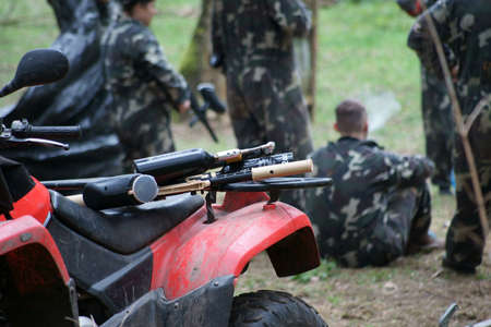 Paintball, quad bikes on the game field. In the background players.