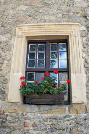 medieval window in the wall of the castle. Stock Photo