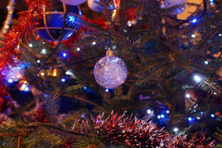 Lonely Christmas Tree bauble on the tree. Stock Photo