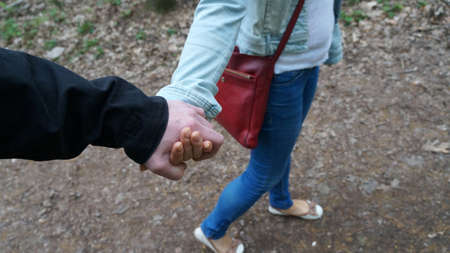 The man is holding the womans hand. Stock Photo
