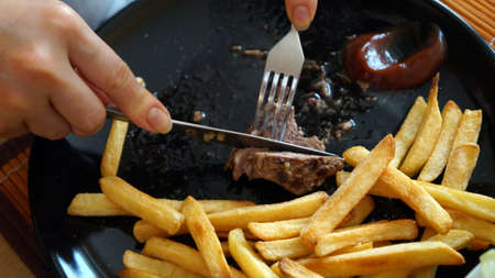 Steak and chips cut.