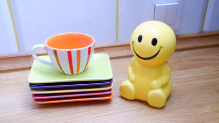 Funny guy and tableware coffee at the kitchen counter.