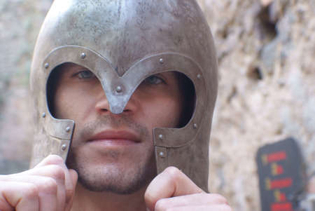 Young man in armor. Helm. Knight.