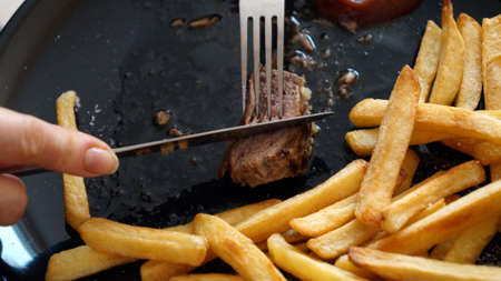 Steak with french fries on a plate. Stock Photo