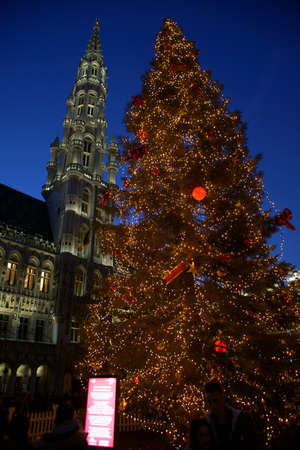 A large Christmas tree on the Grand Place in Brussels. Christmas presents.
