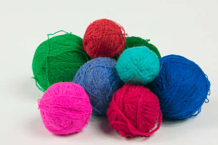 bright multi-colored woolen balls from natural yarn for knitting