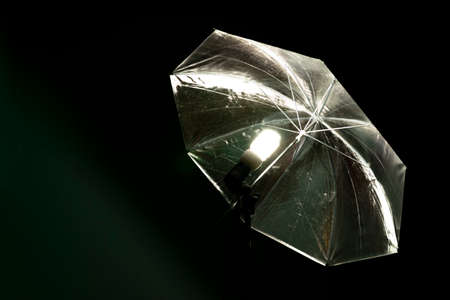 reflective shiny umbrella with the included energy-saving lamp for shooting in photo studio