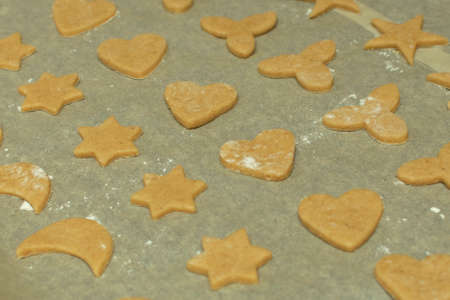 raw gingerbread cookies for Christmas, laid out on a baking tray