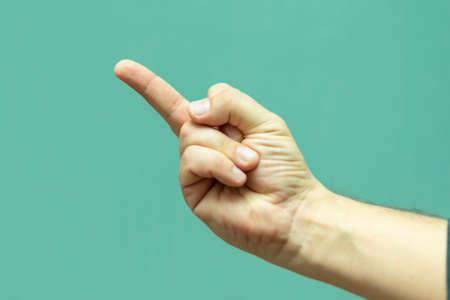 man shows hand gesture close up middle finger Imagens