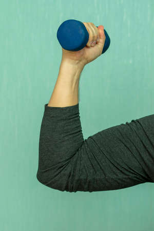 dumbbell in compressed in hand for training muscles