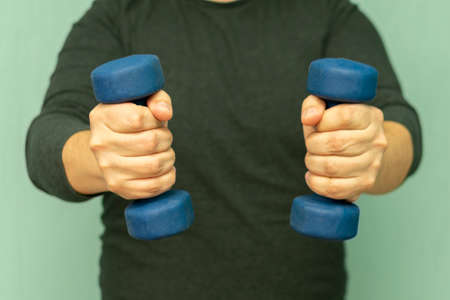 full man hold dumbbells in hand for fitness classes for weight loss Imagens