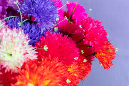 a bouquet of a mixture of different colors of artificial carnations, for decoration