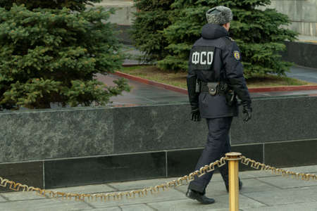 an armed man in uniform, an employee of the Federal Security Service of the Russian Federation keeps order on the red square near the mausoleum in Moscow