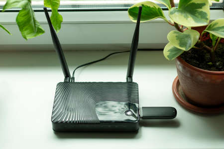 insert a mobile usb modem into the Internet router on the window sill by the window