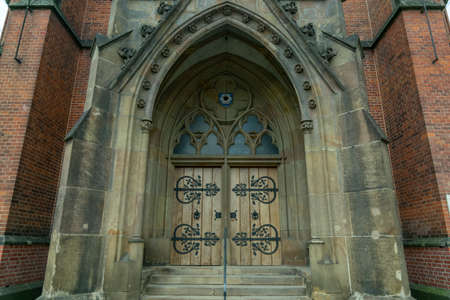 old door, entrance to the ancient church Standard-Bild