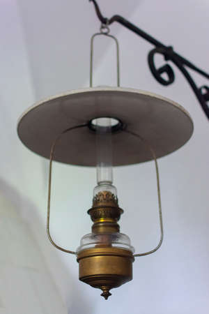 antique oil copper lamp hanging by the wall