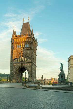 Prague Czech Republic 07.2020 old town with tourist attraction bridge cloudy sky old town with buildings and monuments statue sculpture