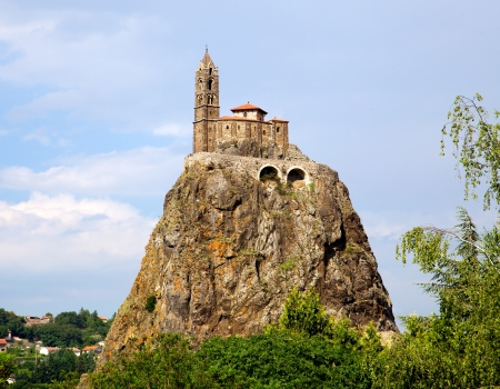 michel: Ancient Chapelle Saint Michel de Aiguilhe standing at a very steep volcanic needle (Le Puy en Velay, France)