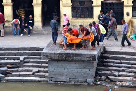 Kathmandu, Nepal - November 7, 2011 - Nepalese people preparing burial ceremony in Pashupatinath Temple in Kathmandu, Nepal. Stock Photo - 17268784