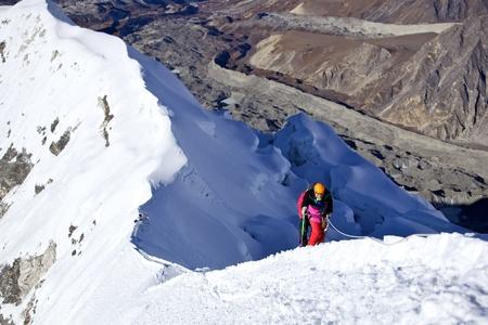 mountaineer: Climbing Island Peak (Imja Tse) in Nepal. Mount summit.