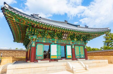 buddhist temple roof: Naksansa (Korean Buddhist Temple complex) that stands on the slopes of Naksan Mountain in  Sokcho, South Korea.