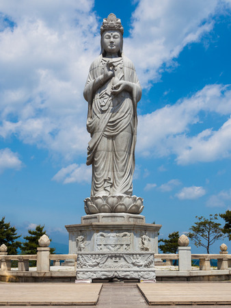 Statue in Naksansa (Korean Buddhist Temple complex) that stands on the slopes of Naksan Mountain in  Sokcho, South Korea.
