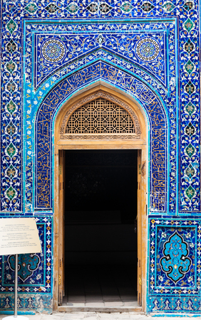 Entrance to mausoleum  decorated by oriental traditional ceramic ornament in Samarkand, Uzbekistan