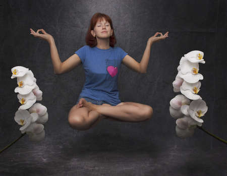 woman meditates in the air photo