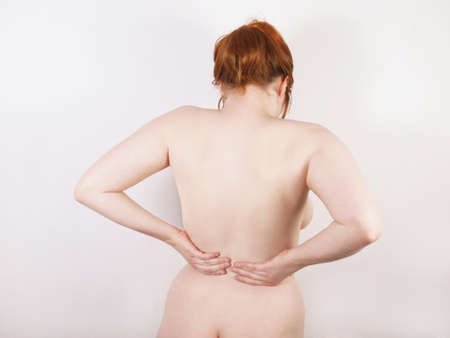 dorsalgia: young woman with back ache